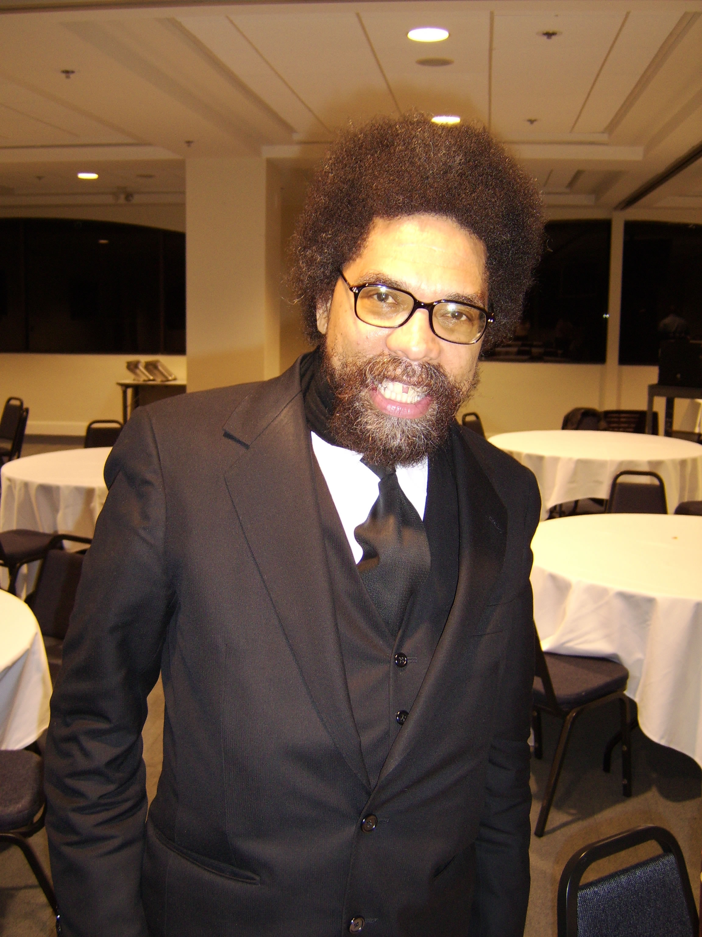 Cornel West in black suit