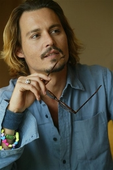 Johnny Depp with girl's necklace