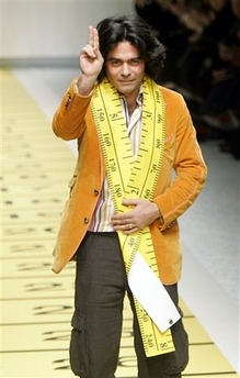 Kean Etro with giant tape measure