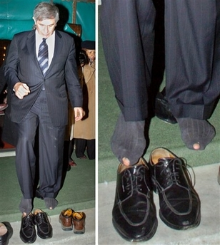 Paul Wolfowitz in holey socks