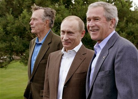 Putin flanked by Bushes