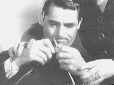 Cary Grant knitting in Mr Lucky