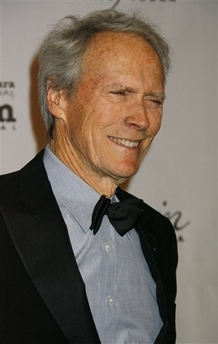 Clint Eastwood in blue shirt and tux