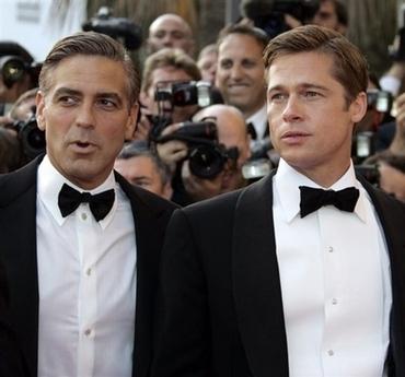 Brad Pitt George Clooney. on George Clooney#39;s shirt.