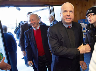 Lieberman and McCain in suits and sweaters