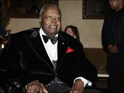 Oscar Peterson in velvet smoking jacket